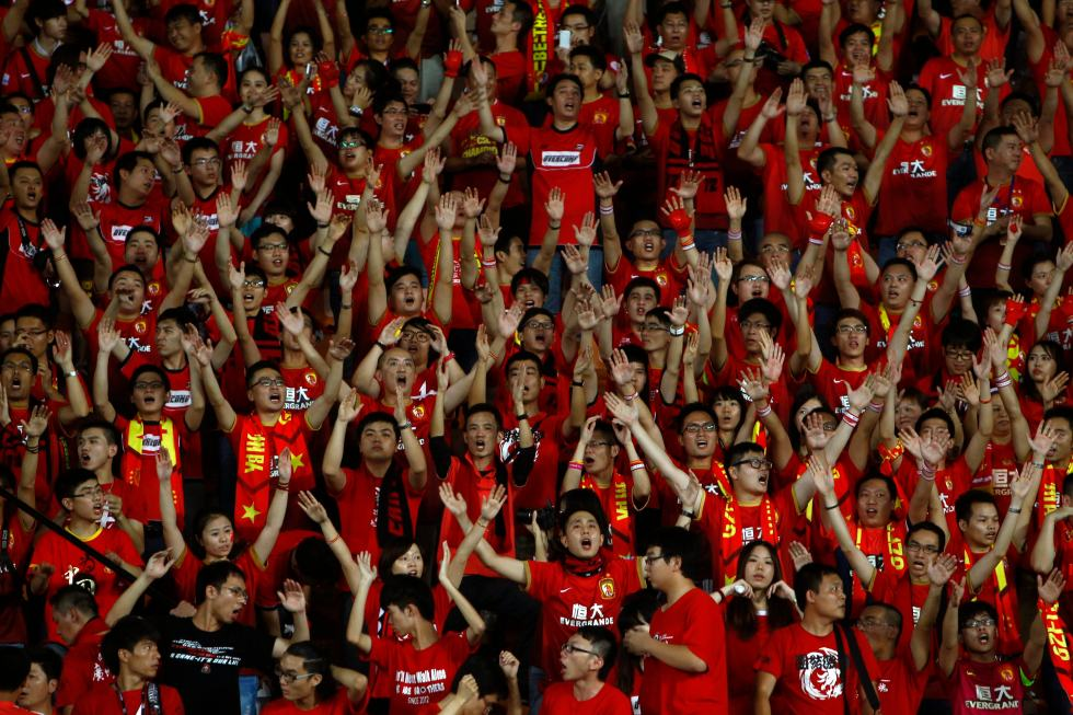 Supporters of Guangzhou Evergrande sing at Tianhe stadium in the southern Chinese city of Guangzhou
